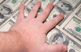 hand on dollar bills