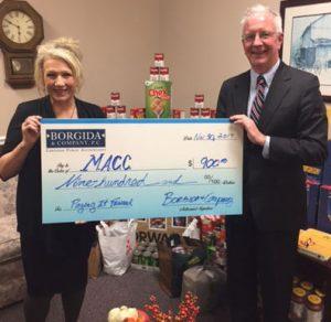 photo of Scanlon & Stafford with big check