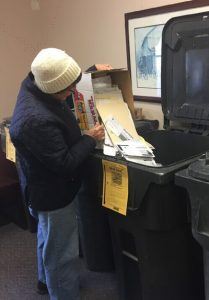 photo of woman empyting box into bin