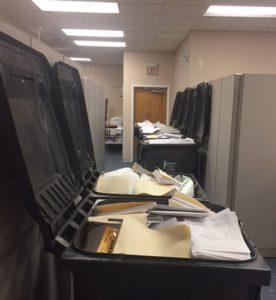 photo of full shred bins