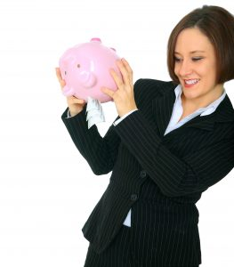 photo of woman exec shaking piggy bank