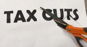 graphic of scissors cutting the word TAX