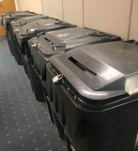 large shred bins lined up