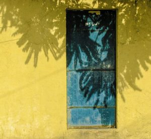 Yellow wall with Blue Door
